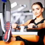 Beautiful woman exercising at the fitness gym