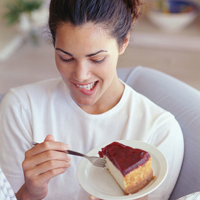 day-1-woman-eating-cheesecake-400x400